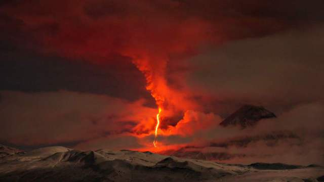 PIC BY MARC SZEGLAT / CATERS NEWS - (PICTURED: The mordor looking volcano) - This incredible scene looks just like Mordor from the Lord of the Rings but its actually a volcanic eruption so powerful it created a lava fountain one kilometre high. Looking like the mythical evil land from the books by J.R.R. Tolkien this volcano is definitely reality erupting this month in Kamchatka, far eastern Russia. Known as the Land of Volcanoes Kamchatka - which is more than 5,000 miles from Moscow - is home to 29 active craters. SEE CATERS COPY